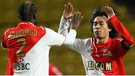 Monaco's Chu-Young Park celebrates with Cedric Mongongu after scoring