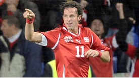 Marco Streller celebrates after putting Switzerland 2-1 up