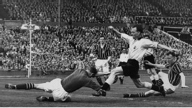 Manchester City 3-1 Birmingham, 1956: Whilst making this save at the feet of Peter Murphy City keeper Bert Trautmann unknowingly broke his neck. He played on to make some crucial saves.