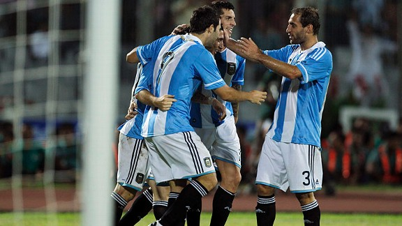Argentina celebrate after Angel Di Maria scores their second goal against Nigeria.