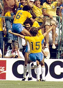 The late Socrates is congratulated on his goal against Italy