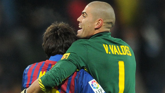 Victor Valdes and Lionel Messi