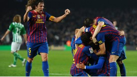 Barcelona's players celebrate Alexis Sanchez's scoring a goal
