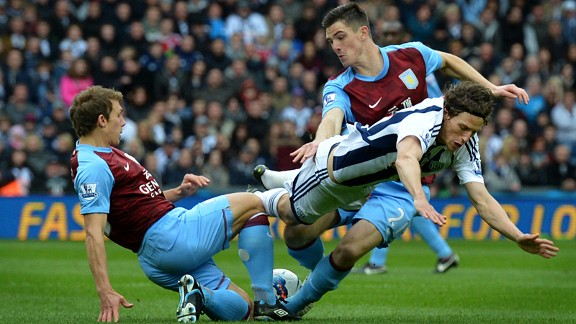 Aston Villa's Stephen Warnock and Ciaran Clark chop down West Brom's Billy Jones