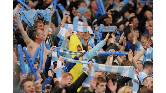 Manchester City fans celebrate their 1-0 victory amid jubilant scenes
