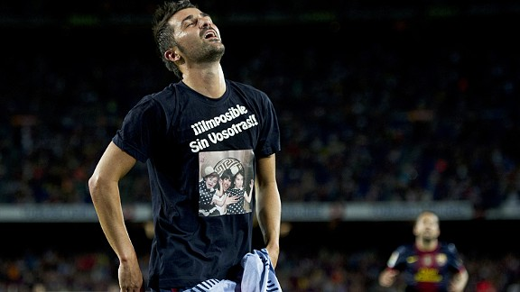 David Villa celebrates after marking his first appearance after injury with Barcelona's fifth goal