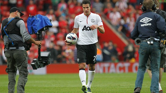 Robin van Persie walks off with the matchball