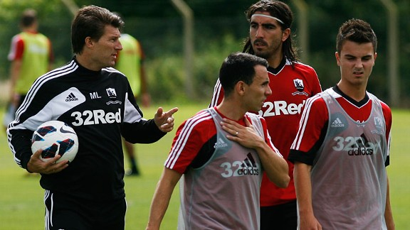 Swansea manager Michael Laudrup puts his players through their paces