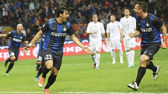Inter Milan celebrate after Gabriel Milito scored against Fiorentina