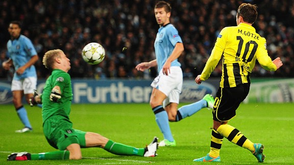 Manchester City goalkeeper Joe Hart blocks the shot of Mario Gotze of Borussia Dortmund
