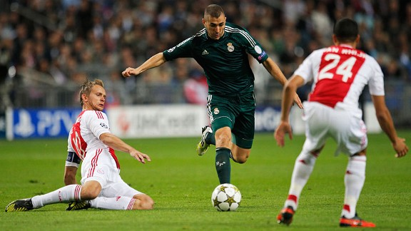 Ajax players Siem de Jong, left, and Ricardo van Rhijn, right, try and stop Real Madrid goalscorer Karim Benzema