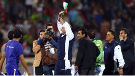 Carlos Queiroz celebrated in front of a frenzied crowd in Tehran's Azadi Stadium