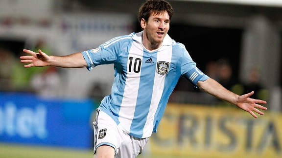 Lionel Messi celebrates scoring the opening goal against Chile