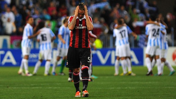 Philippe Mexes shows his frustration as AC Milan suffer defeat in Malaga