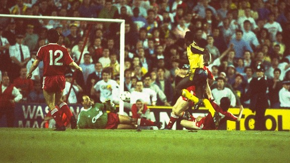 Michael Thomas beats goalkeeper Bruce Grobbelaar to score their second title clinching goal in 1989