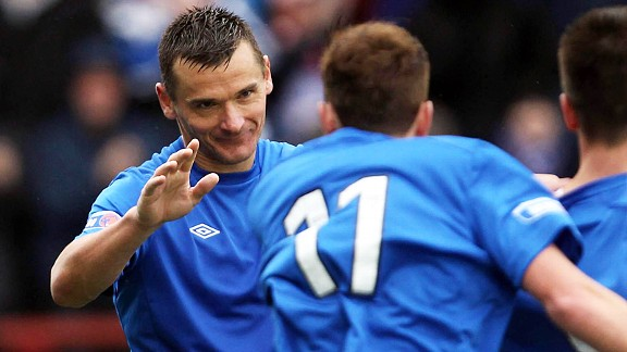 Lee McCulloch celebrates after securing the points