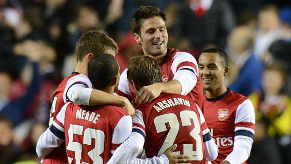 Arsenal celebrate after netting their seventh goal to complete their victory