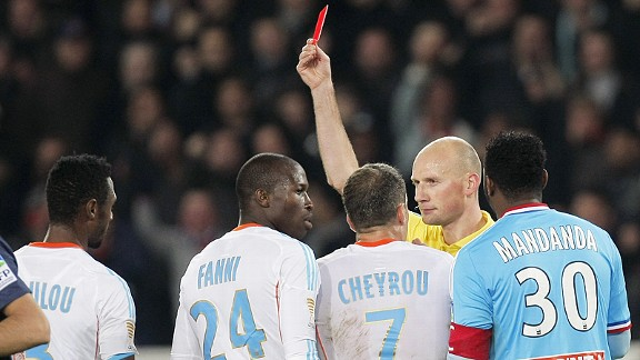 Marseille's Rod Fanni is sent off against PSG, ending the game as a meaningful contest
