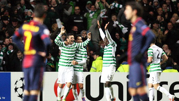 Celtic celebrate Tom Watt's goal as Barcelona wait to get the match restarted