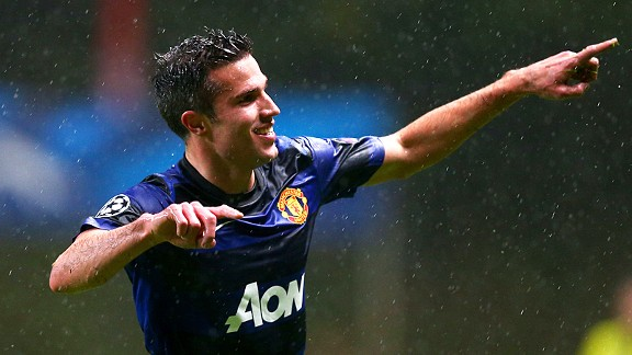 Robin van Persie celebrates the first of Man United's trio of goals as they came from behind to win at Braga