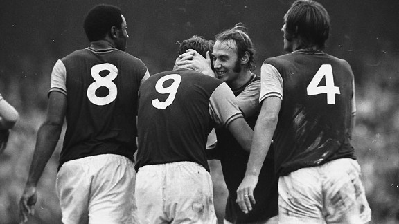 West Ham's Bryan 'Pop' Robson hugs the England hero Geoff Hurst
