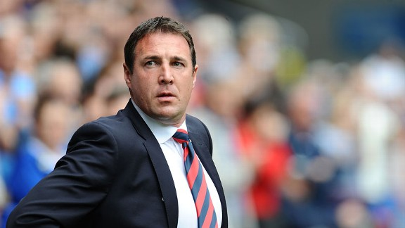 Malky Mackay's Cardiff stayed top of the Championship table despite a 1-1 draw with Derby