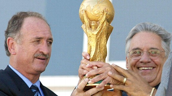 Brazil coach Luiz Scolari holds aloft the World Cup in 2002