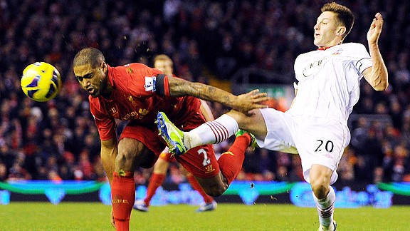 Adam Lallana gets a challenge in on Glen Johnson