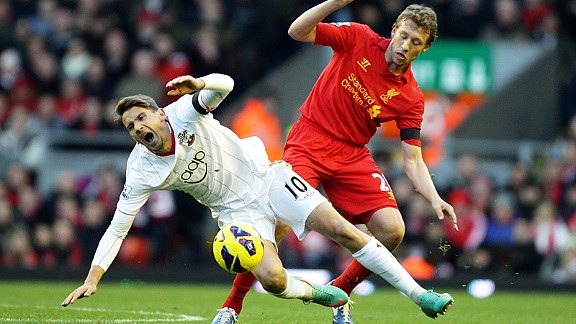 Lucas Leiva, back in the Liverpool team, lets Gaston Ramirez know he's around