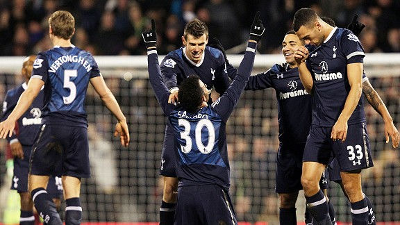 Spurs celebrate after Sandro scored a late goal to put his side in front at Fulham