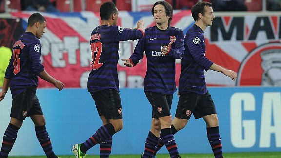 Tomas Rosicky celebrates his goal on his first start of the season