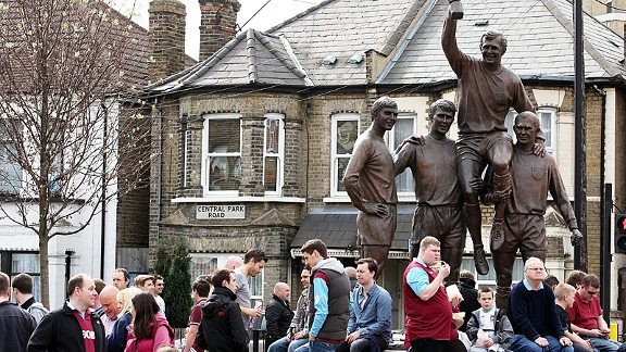 West Ham fans gather by the Champions statue at the top of Green Street