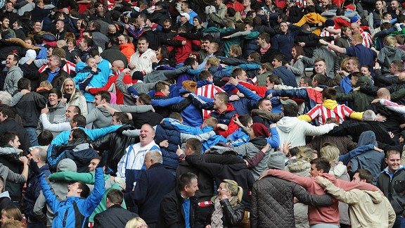 Sunderland fans celebrate Manchester City beating Manchester United to the Premier League title by doing the Poznan.