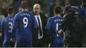 Rafael Benitez congratulates his Chelsea charges as they leave the pitch