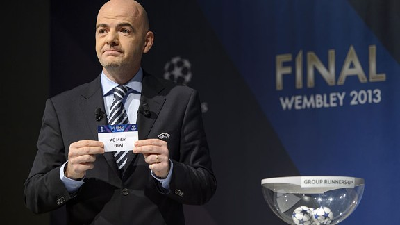 UEFA general secretary Gianni Infantino picks out AC Milan