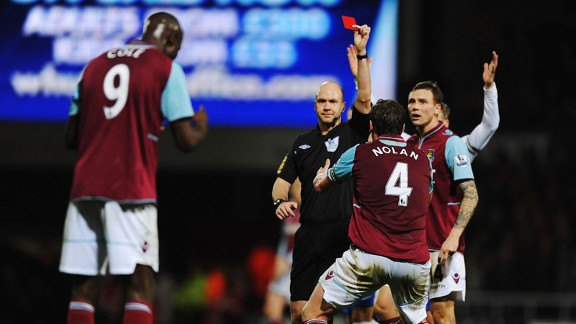 Referee Anthony Taylor shows West Ham striker Carlton Cole a red card