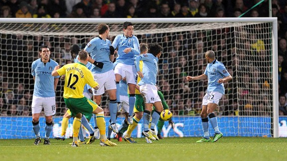 Anthony Pilkington scores from a free-kick to reduce the deficit against Manchester City