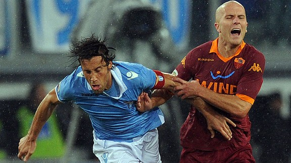 Michael Bradley tussles with Lazio's Stefano Mauri in the Rome derby