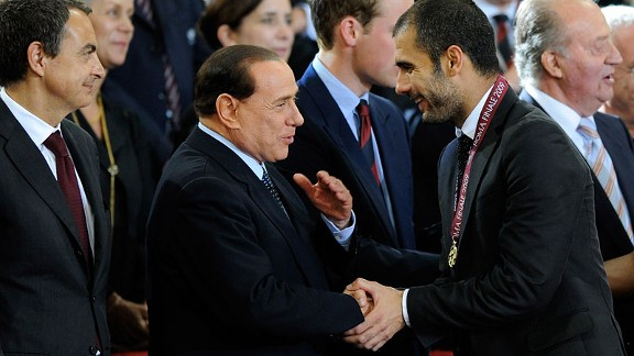 AC Milan president Silvio Berlusconi says he has met with former Barcelona manager Josep Guardiola.