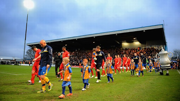 The show begins: Mansfield and Liverpool take to the pitch