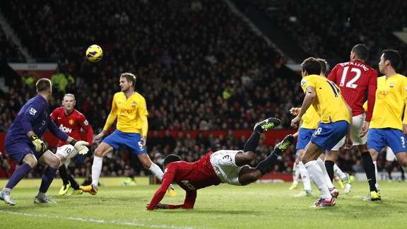 Patrice Evra sets up Wayne Rooney for his second goal of the night