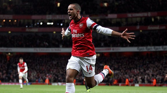 Theo Walcott celebrates after levelling the scores at 2-2