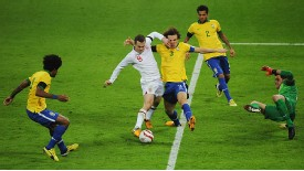 Jack Wilshere of England takes on Brazil