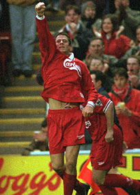Jamie Carragher salutes the crowd after scoring on his Anfield debut