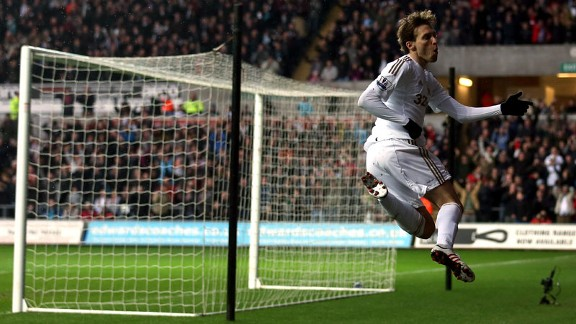 Michu celebrates giving Swansea the lead against QPR