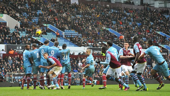 Charles N'Zogbia doubles Villa's lead with a free-kick