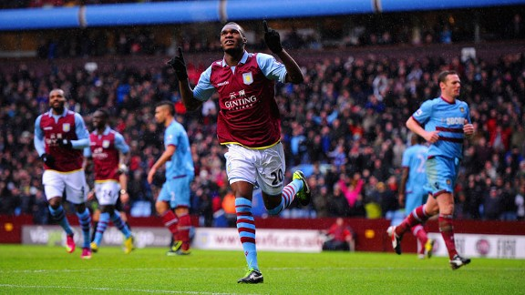 Christian Benteke celebrates putting Aston Villa into the lead from the penalty spot