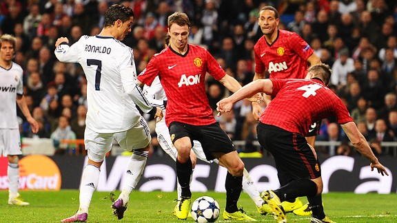 Phil Jones and Jonny Evans make sure Cristiano Ronaldo gets no space in the box