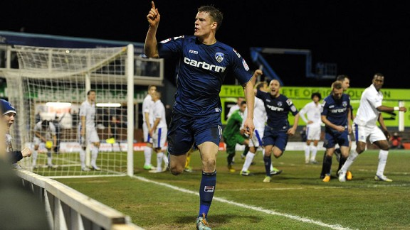 Matt Smith celebrates his injury-time equaliser for Oldham