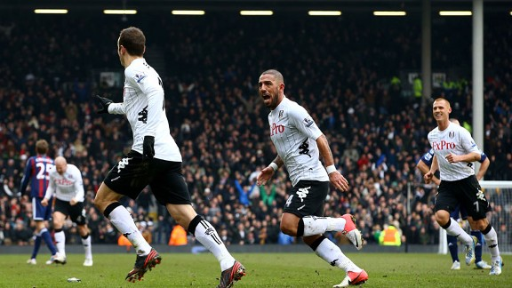 Dimitar Berbatov peels away after scoring for Fulham against Stoke